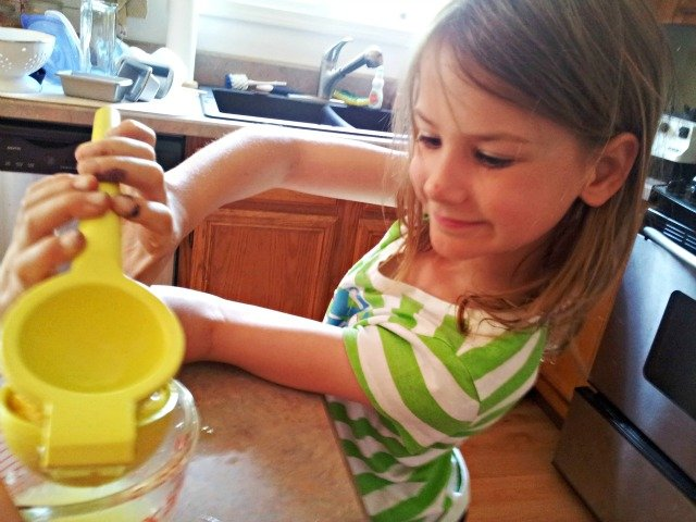 Little Miss squeezing lemons for homemade lemonade