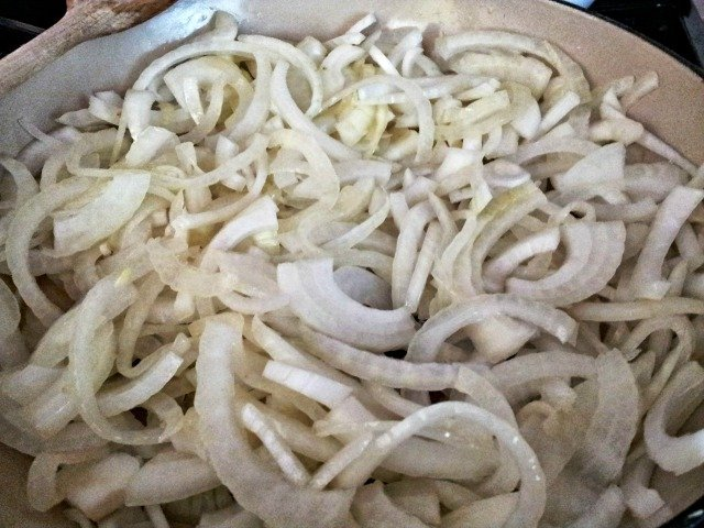 Sliced onions in the pan ready to cook