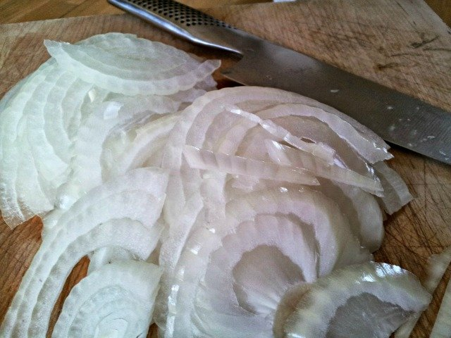 Slice onions thinly to caramelize them well