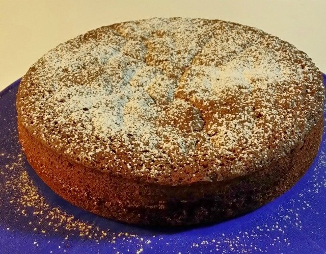Chocolate olive oil cake with powdered sugar dusting