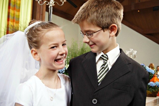 Siblings proud of First Communion