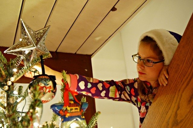 Placing the star atop the tree