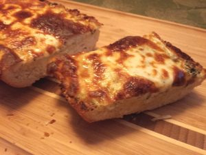 Slice of cheesy garlic bread